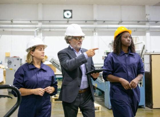 Man and women walking through factory