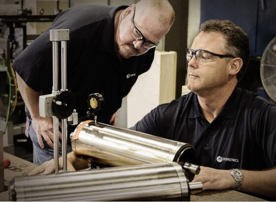 Men inspecting rotary die