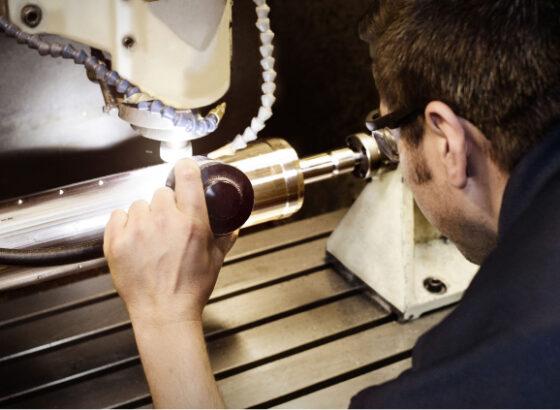 Man working on rotary die
