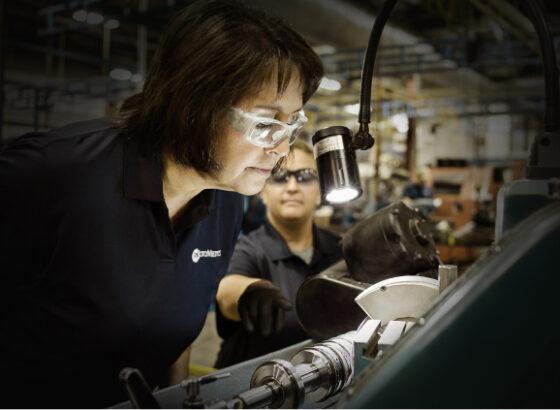 Woman inspecting machine